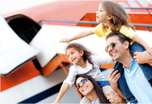 Happy family traveling by airplane