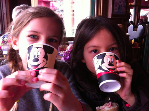 2 children drinking hot chocolate at Disneyland cafe