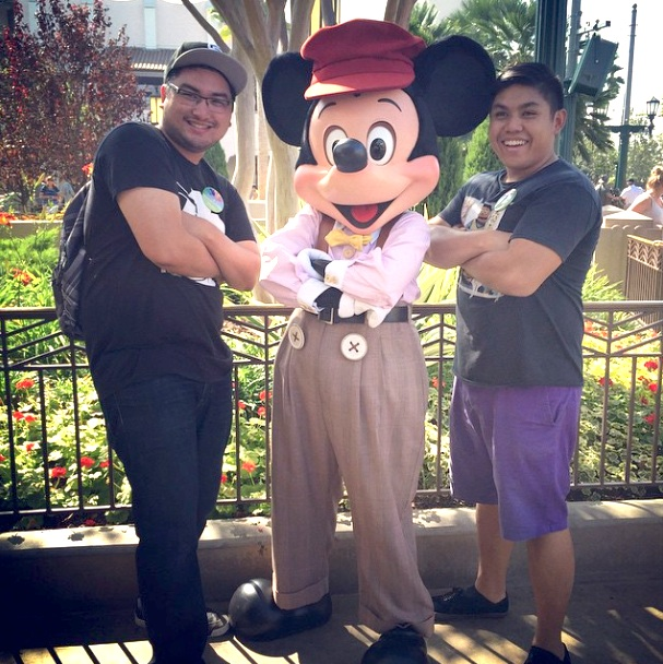 2 brothers taking a photo with Mickey at Disney Park Oct 2014