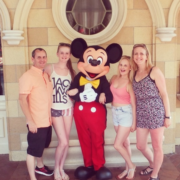 Family picture with Mickey Mouse at Disneyland